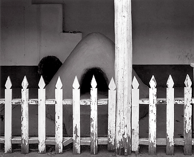 Fence and Horno, New Mexico. Black and white photograph