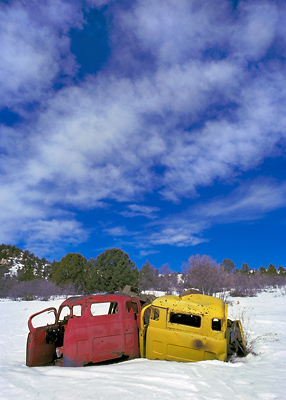 Junk Trucks In Snow, 1980. Alton, Utah. Color Photograph
